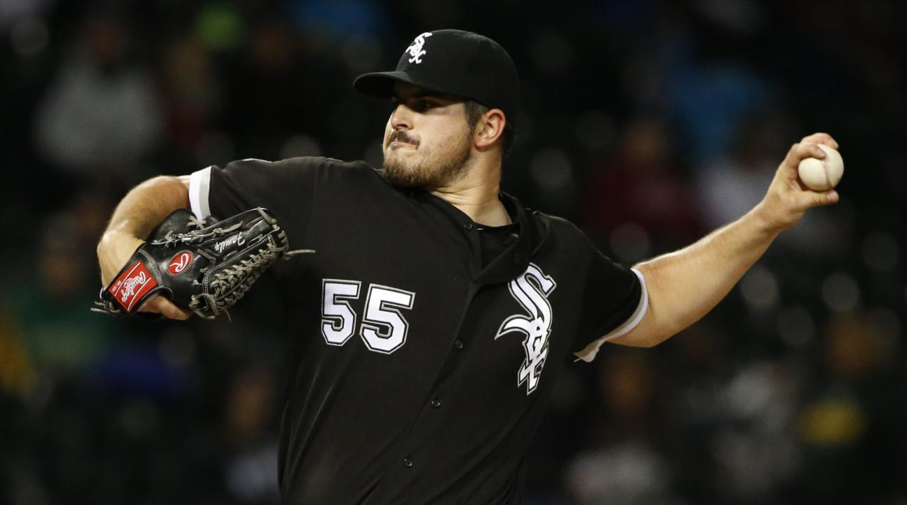 Chicago White Sox starter Carlos Rodon throws against the Minnesota Twins during the first inning of a baseball game Friday, Sept. 30, 2016, in Chicago. (AP Photo/Nam Y. Huh)