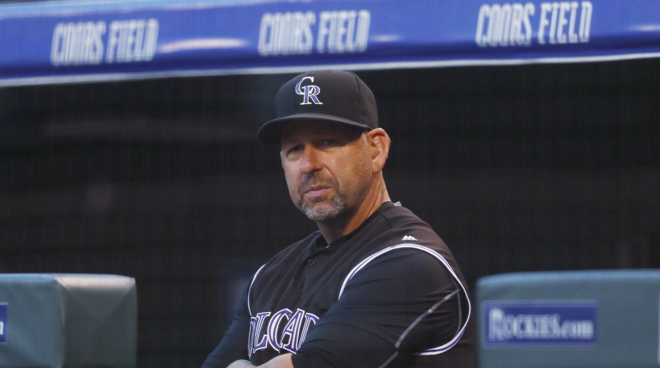 Colorado Rockies manager Walt Weiss watches during the first inning of the team's baseball game against the Milwaukee Brewers on  Friday, Sept. 30, 2016, in Denver. (AP Photo/David Zalubowski)
