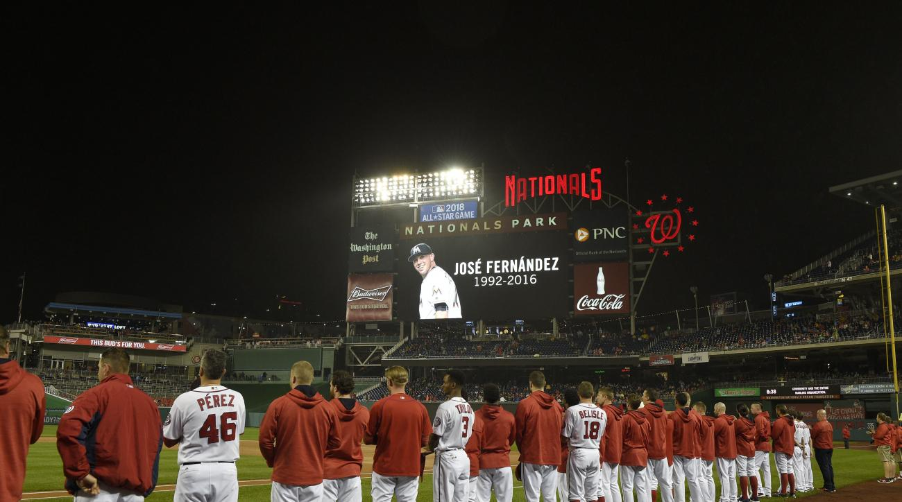 A video board pays tribute to the late Miami Marlins' Jose Fernandez before a baseball game between the Washington Nationals and the Marlins, Friday, Sept. 30, 2016, in Washington. (AP Photo/Nick Wass)
