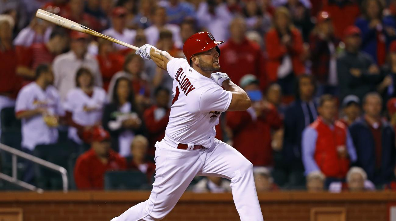 St. Louis Cardinals' Matt Holliday watches his home run to right field during the seventh inning of a baseball game against the Pittsburgh Pirates, Friday, Sept. 30, 2016, in St. Louis. (AP Photo/Billy Hurst)