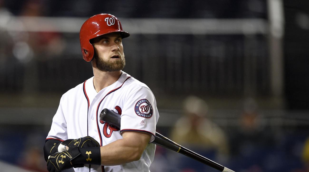 Washington Nationals' Bryce Harper walks back to the dugout after he struck out during the eighth inning of a baseball game against the Miami Marlins, Friday, Sept. 30, 2016, in Washington. The Marlins won 7-4. (AP Photo/Nick Wass)