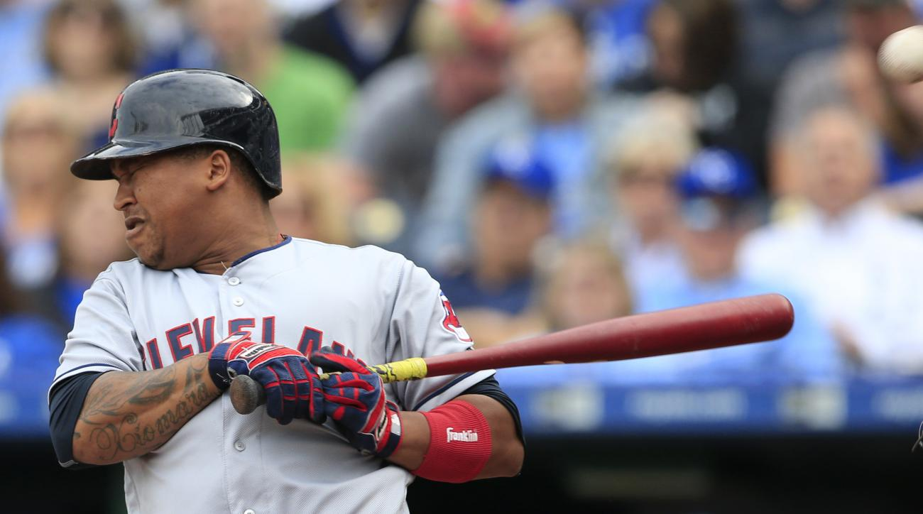 Cleveland Indians' Jose Ramirez is hit by a pitch from Kansas City Royals starting pitcher Edinson Volquez during the first inning of a baseball game at Kauffman Stadium in Kansas City, Mo., Saturday, Oct. 1, 2016. (AP Photo/Orlin Wagner)