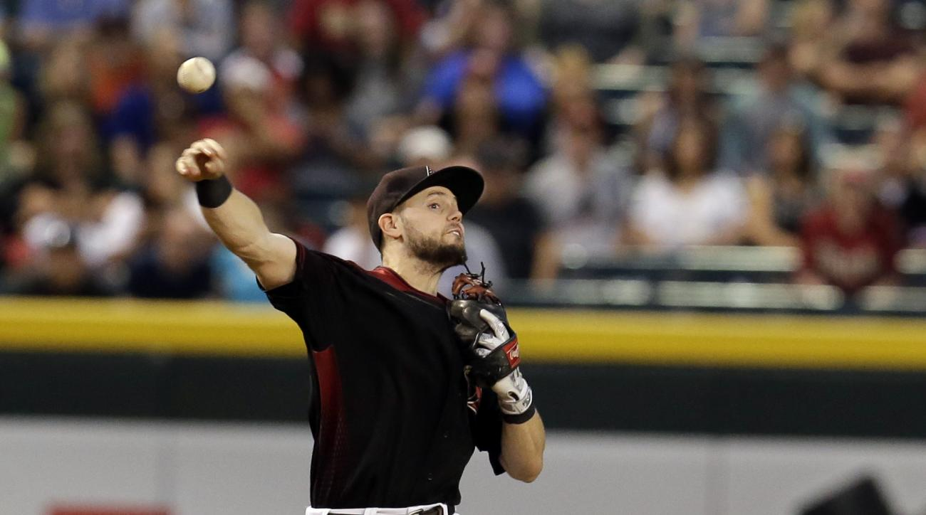 Arizona Diamondbacks shortstop Chris Owings makes an off-balance throw on a ball hit by San Diego Padres' Luis Sardinas in the fourth inning during a baseball game, Saturday, Oct. 1, 2016, in Phoenix. (AP Photo/Rick Scuteri)
