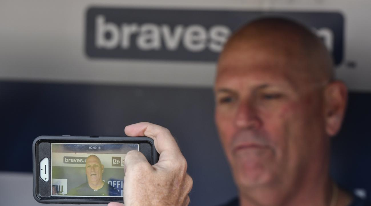 Atlanta Braves interim manager Brian Snitker is interviewed by the media before the Braves' last baseball game at Turner Field before playing the Detroit Tigers, Sunday, Oct. 2, 2016, in Atlanta. The franchise is planning on starting the 2017 season at Su