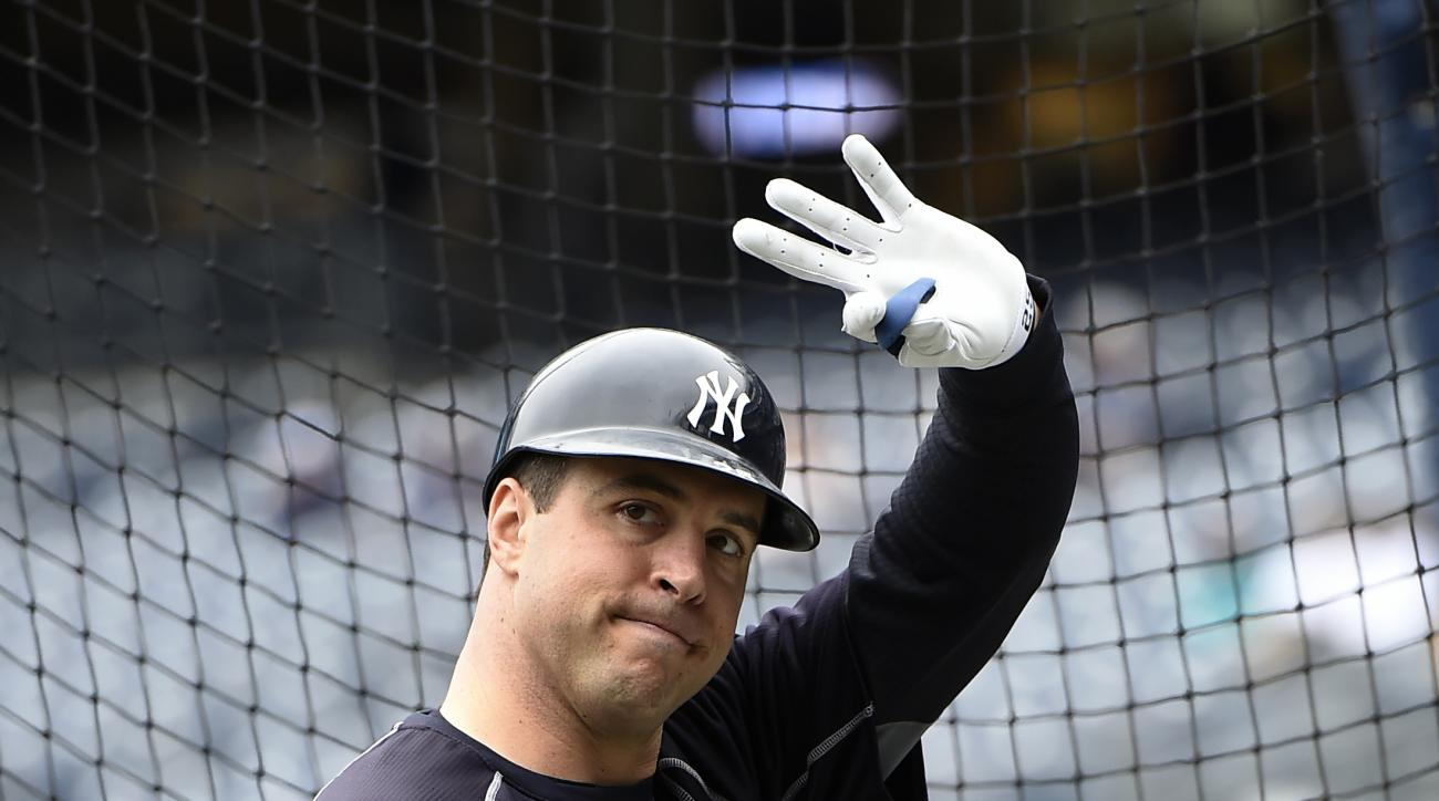 New York Yankees first baseman Mark Teixeira waves to fans during batting practice before a baseball game against the Baltimore Orioles, Sunday, Oct. 2, 2016, in New York. Teixeira is retiring after the game. (AP Photo/Kathy Kmonicek)