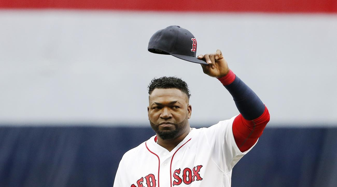 Boston Red Sox's David Ortiz tips his cap to the crowd during ceremonies before a baseball game against the Toronto Blue Jays in Boston, Sunday, Oct. 2, 2016. (AP Photo/Michael Dwyer)