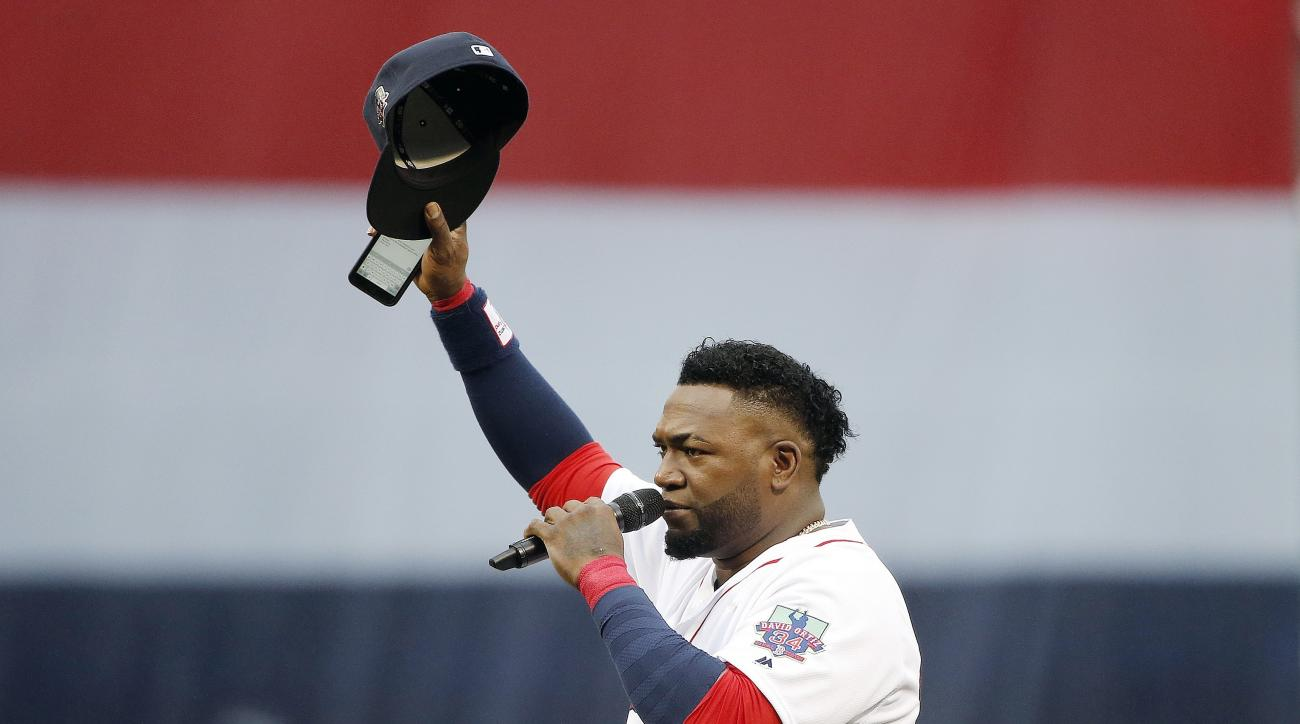 Boston Red Sox's David Ortiz tips his cap while addressing the crowd during ceremonies before a baseball game against the Toronto Blue Jays in Boston, Sunday, Oct. 2, 2016. (AP Photo/Michael Dwyer)