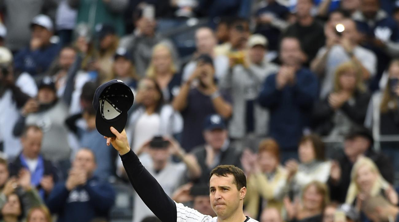 New York Yankees first baseman Mark Teixeira waves to fans as he leaves a baseball game against the Baltimore Orioles, Sunday, Oct. 2, 2016, in New York. Teixeira is retiring after the game. (AP Photo/Kathy Kmonicek)