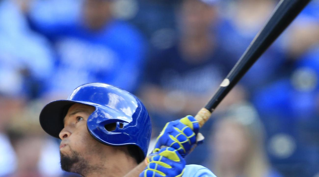 Kansas City Royals' Cheslor Cuthbert hits a solo home run off Cleveland Indians starting pitcher Josh Tomlin during the fifth inning of a baseball game at Kauffman Stadium in Kansas City, Mo., Sunday, Oct. 2, 2016. (AP Photo/Orlin Wagner)