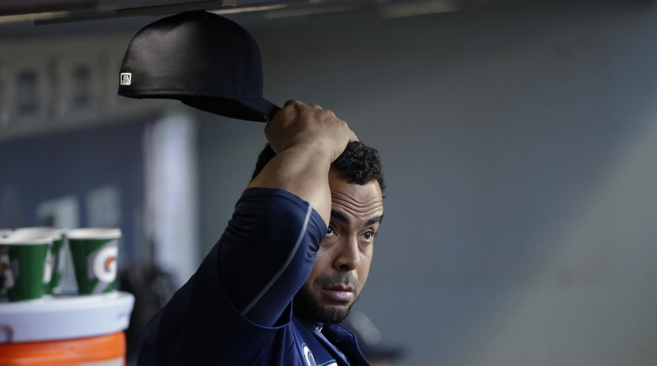 Seattle Mariners' Nelson Cruz stands in the dugout during the eighth inning of a baseball game against the Oakland Athletics, Sunday, Oct. 2, 2016, in Seattle. (AP Photo/Ted S. Warren)