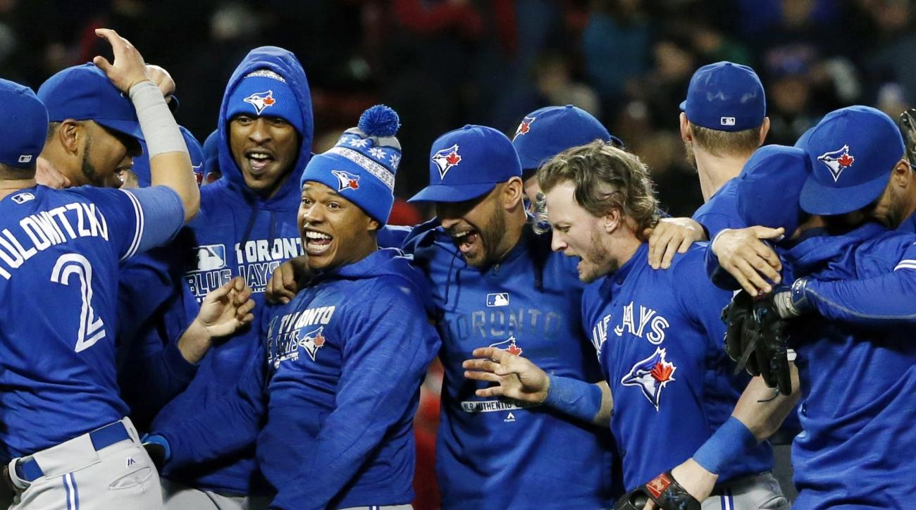 The Toronto Blue Jays celebrate after clinching a wildcard playoff spot by defeating the Boston Red Sox 2-1 during a baseball game in Boston, Sunday, Oct. 2, 2016. AP Photo/Michael Dwyer)