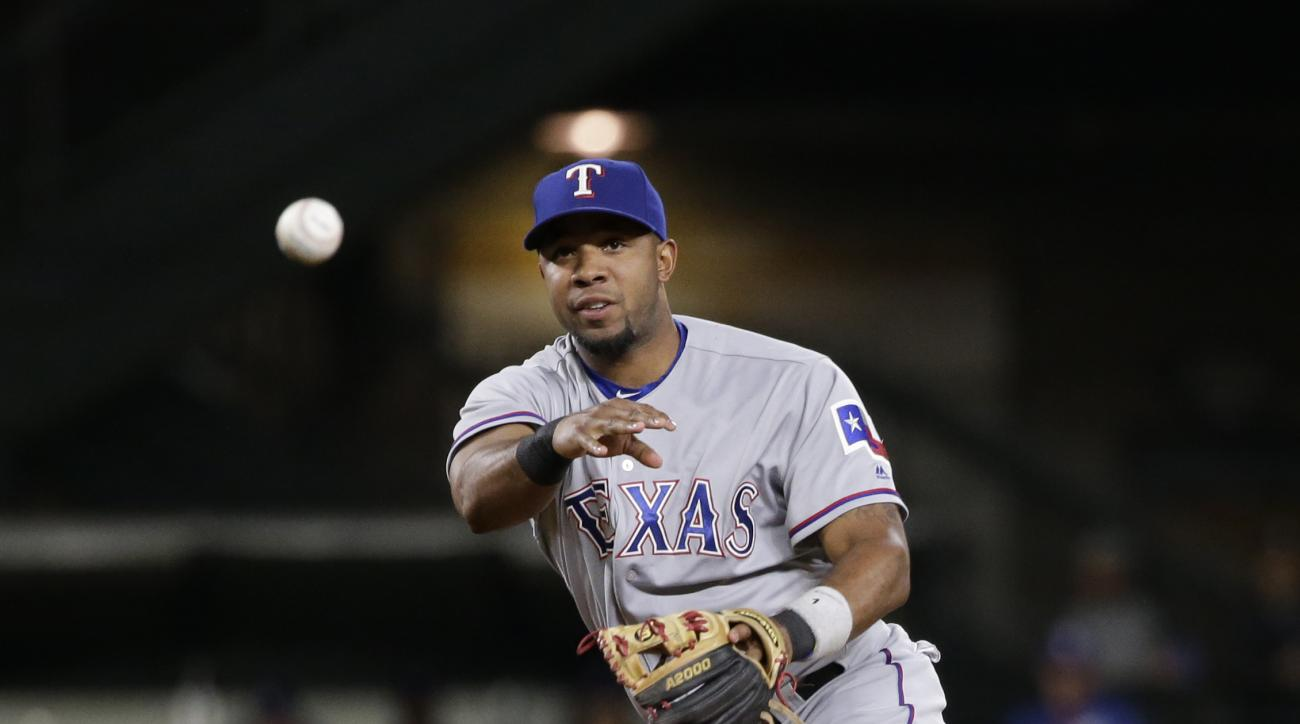 FILE - In this Sept. 6, 2016, file photo, Texas Rangers shortstop Elvis Andrus makes a throw against the Seattle Mariners in the second inning of a baseball game, in Seattle. Andrus refuses to be defined by what happened last October, when the Rangers sho