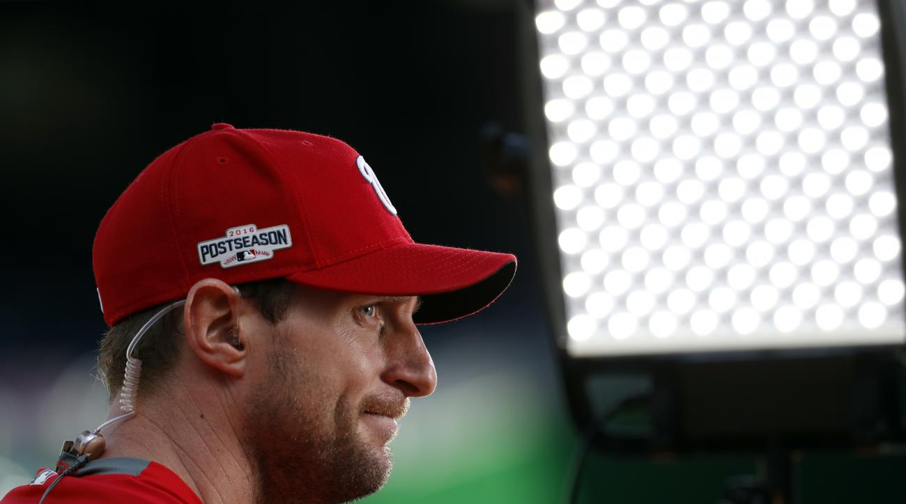 Washington Nationals starting pitcher Max Scherzer pauses before an interview after baseball batting practice at Nationals Park, Tuesday, Oct. 4, 2016, in Washington. The Nationals host the Los Angeles Dodgers in Game 1 of the National League Division Ser