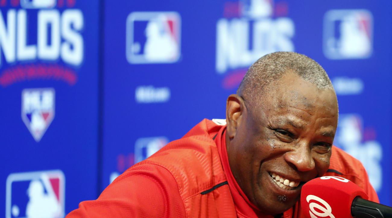 Washington Nationals manager Dusty Baker smiles during a news conference after baseball batting practice at Nationals Park, Tuesday, Oct. 4, 2016, in Washington. The Nationals host the Los Angeles Dodgers in Game 1 of the National League Division Series o