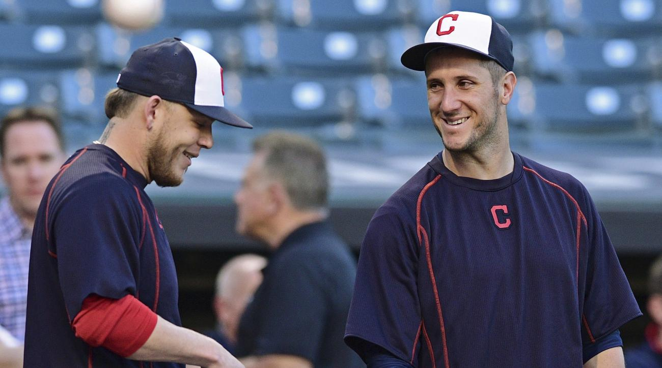 Cleveland Indians' Yan Gomes, right, laughs with Roberto Perez during an infield team-workout, Tuesday Oct. 4, 2016, in Cleveland. The Indians start the American League Divisional Series against the Boston Red Sox on Thursday in Cleveland. (AP Photo/David