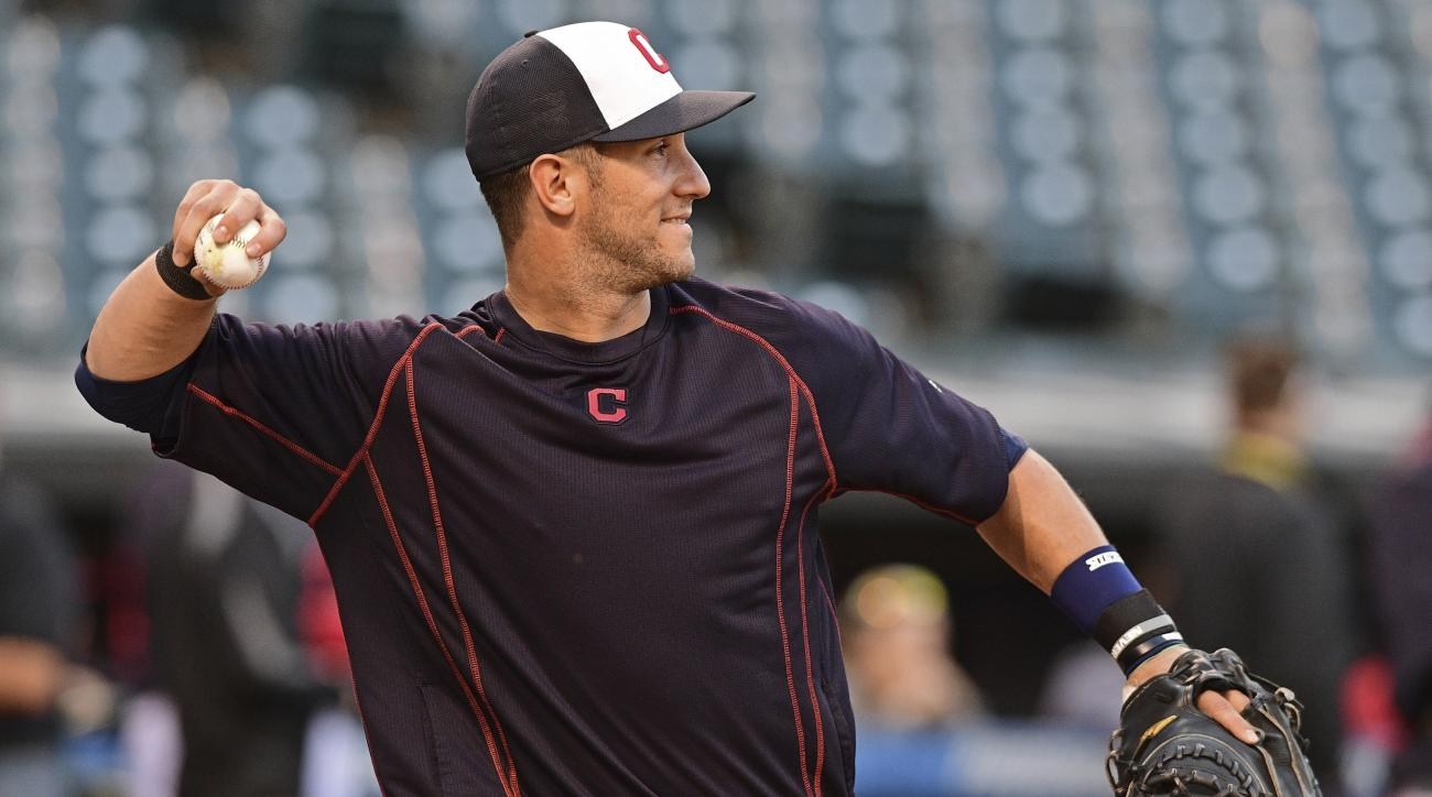 Cleveland Indians' Yan Gomes throws during an infield team-workout, Tuesday Oct. 4, 2016, in Cleveland. The Indians start the American League Divisional Series against the Boston Red Sox on Thursday in Cleveland. (AP Photo/David Dermer)