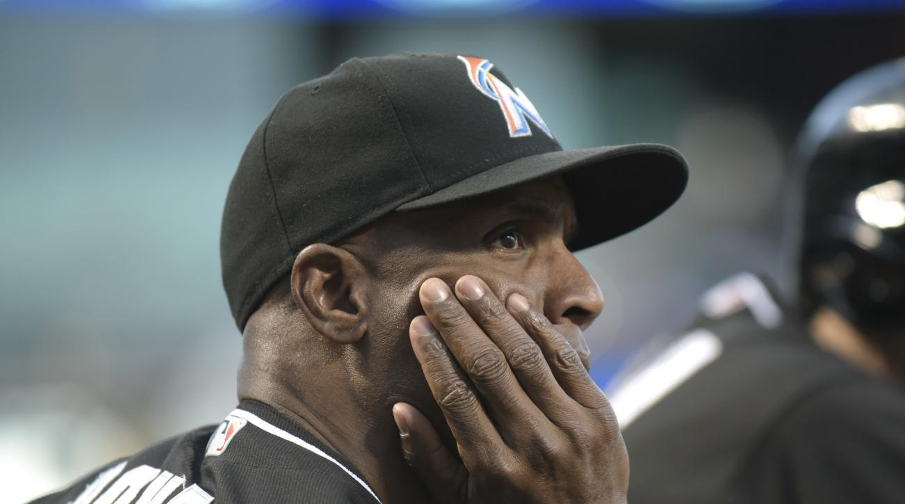 FILE - In this Aug. 29, 2016, file photo, Miami Marlins hitting coach Barry Bonds looks on during the first inning of a baseball game against the New York Mets, at Citi Field in New York. The Miami Marlins have fired hitting coach Barry Bonds, third base