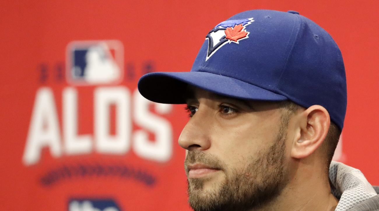 Toronto Blue Jays starting pitcher Marco Estrada listens to a question during a baseball news conference Wednesday, Oct. 5, 2016, in Arlington, Texas. Estrada is scheduled to start Game 1 of the American League Division Series against the Texas Rangers is