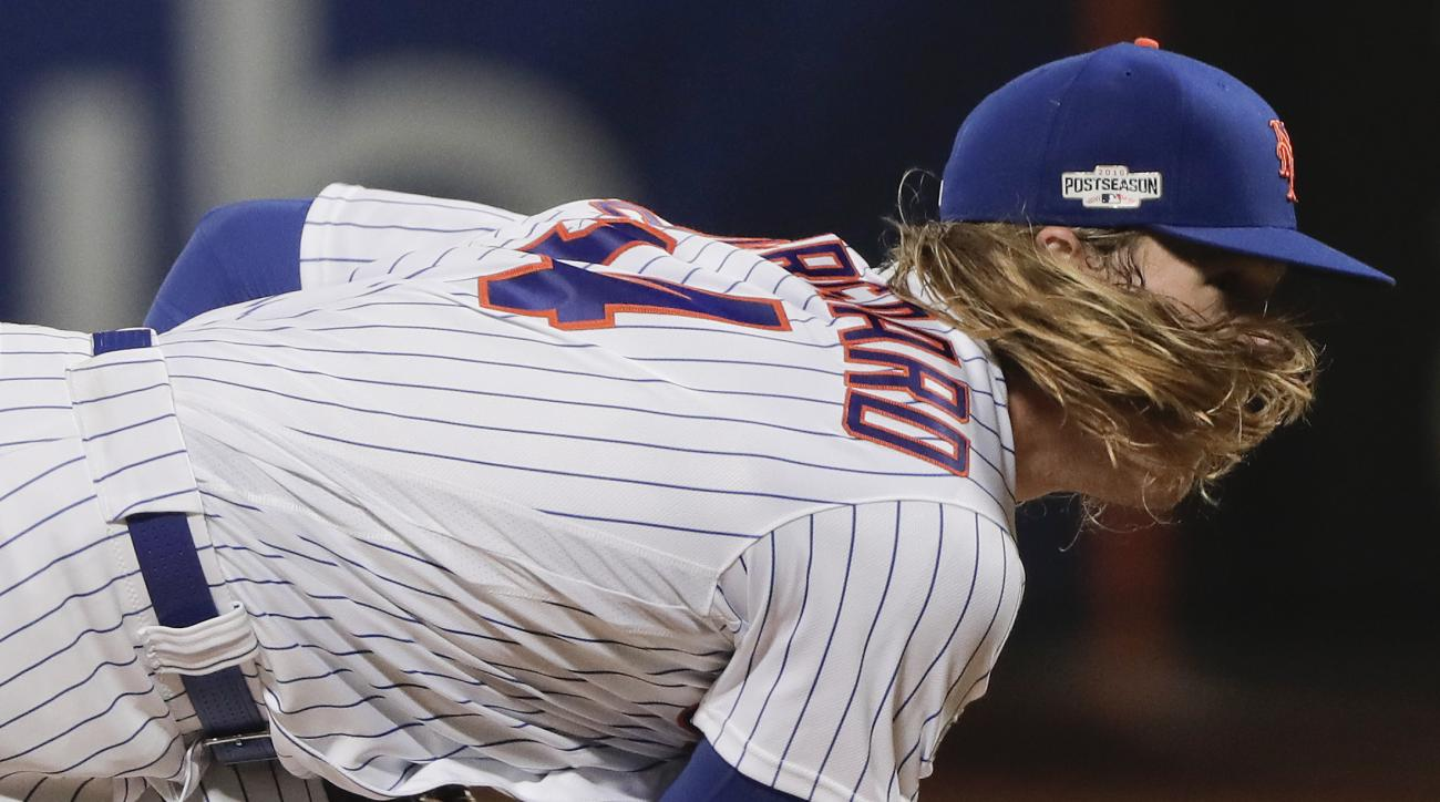 New York Mets starting pitcher Noah Syndergaard (34) delivers against the San Francisco Giants during the third inning of the National League wild-card baseball game, Wednesday, Oct. 5, 2016, in New York. (AP Photo/Julie Jacobson)