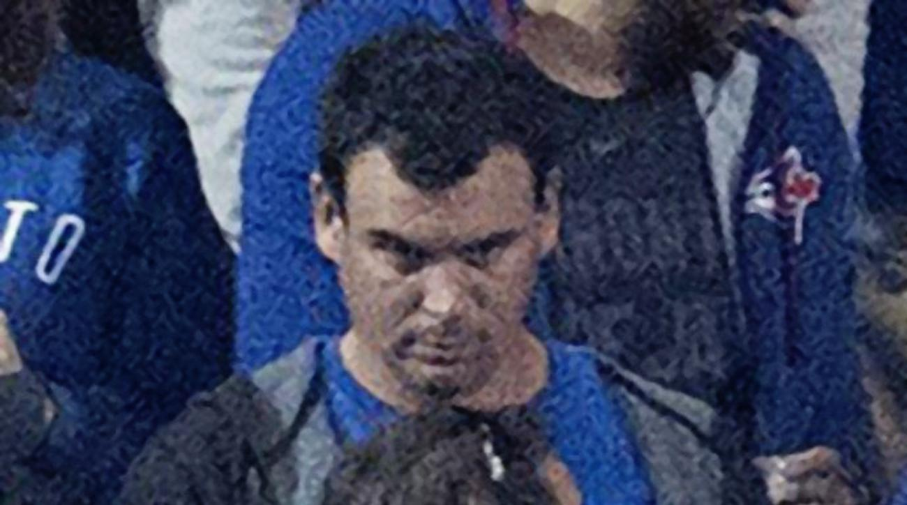 This Tuesday, Oct. 4, 2016, photo shows a man during the seventh inning of the American League wild-card game between the Baltimore Orioles and the Toronto Blue Jays in Toronto. Toronto police have identified the man as the suspect who threw a beer can at