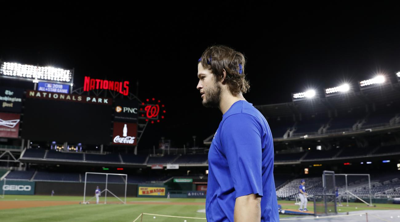 Los Angeles Dodgers starting pitcher Clayton Kershaw walks on the field during baseball batting practice at Nationals Park, Wednesday, Oct. 5, 2016, in Washington. The Nationals host the Los Angeles Dodgers in Game 1 of the National League Division Series