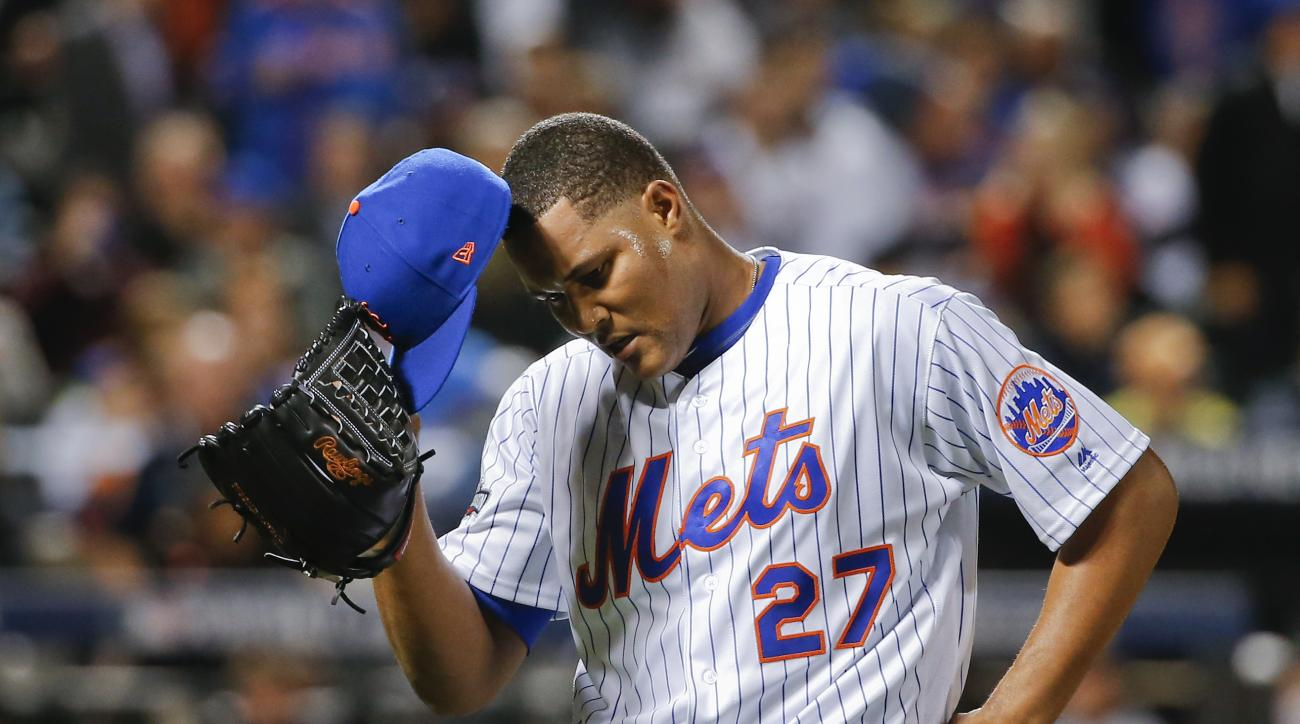 New York Mets relief pitcher Jeurys Familia (27) walks off the field at the end of the top of the ninth inning after giving up a three-run home run to San Francisco Giants' Conor Gillaspie during the National League wild-card baseball game, Wednesday, Oct