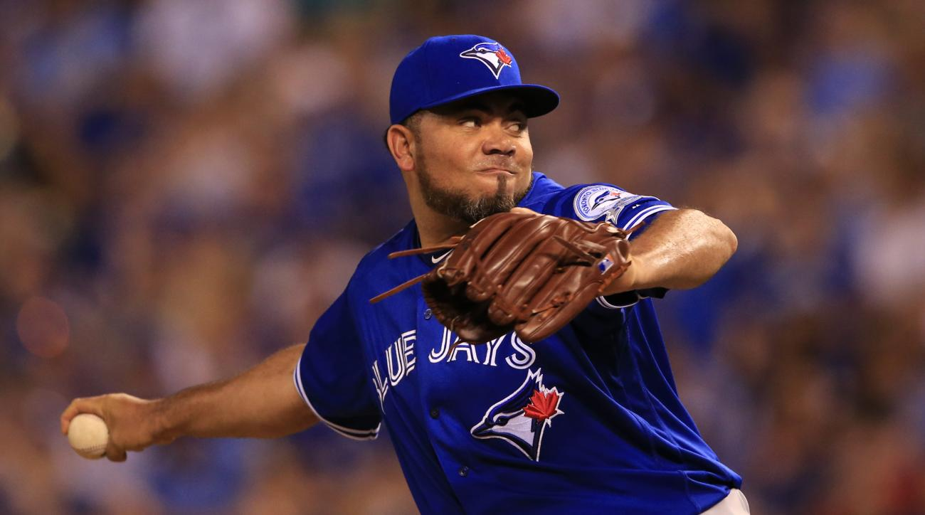 In this photo taken Aug. 5, 2016, Toronto Blue Jays relief pitcher Joaquin Benoit pitches during a baseball game against the Kansas City Royals at Kauffman Stadium in Kansas City, Mo. Most major league teams deal with injuries of some significance at some