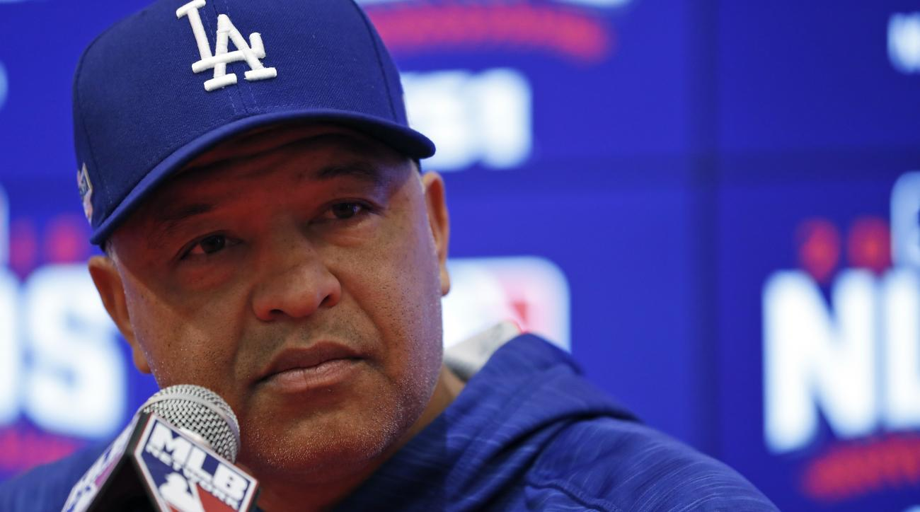 Los Angeles Dodgers manager Dave Roberts listens to a question during a media availability before baseball batting practice at Nationals Park, Thursday, Oct. 6, 2016, in Washington. The Nationals host the Los Angeles Dodgers in Game 1 of the National Leag
