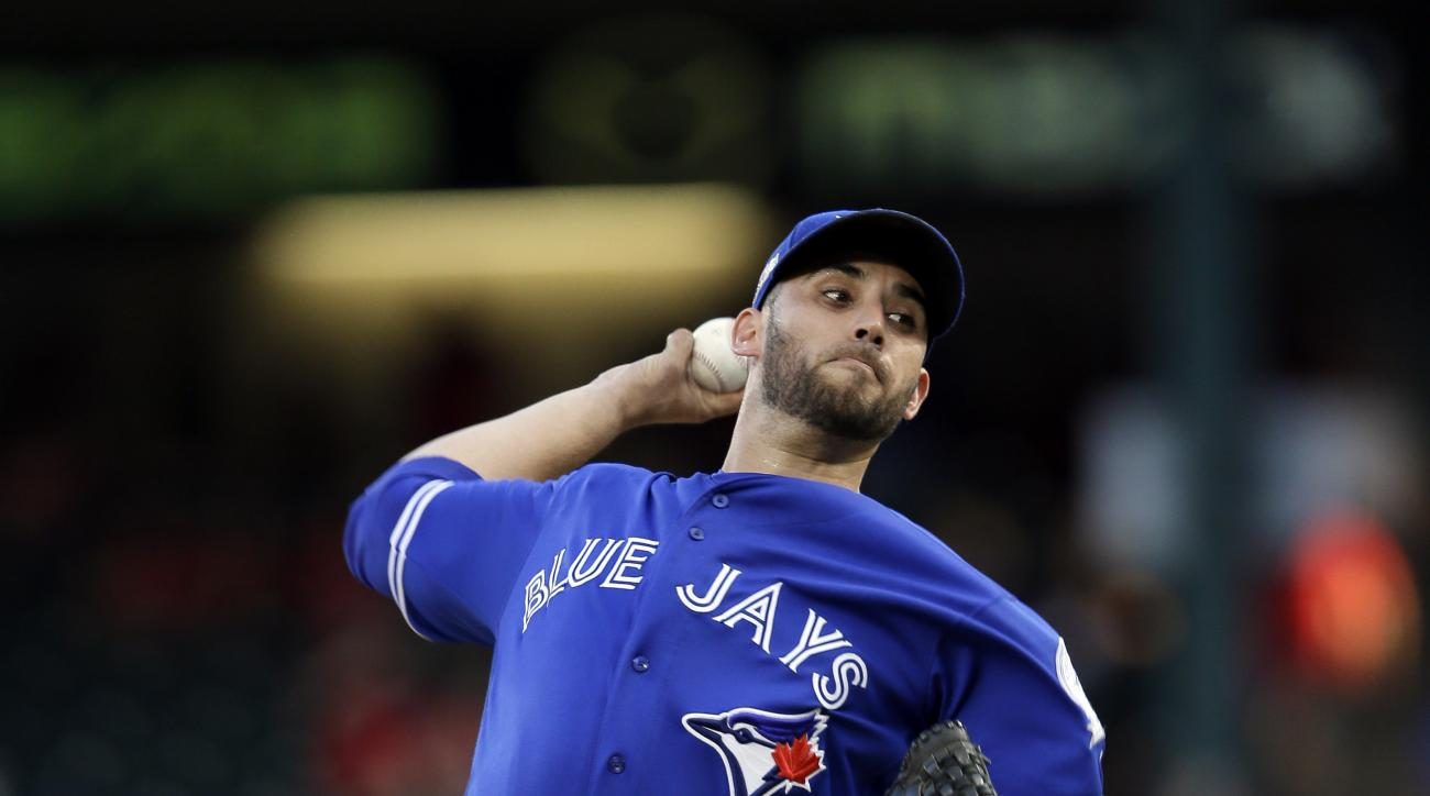 Toronto Blue Jays starting pitcher Marco Estrada throws to a Texas Rangers batter during the ninth inning of Game 1 of baseball's American League Division Series, Thursday, Oct. 6, 2016, in Arlington, Texas. The Blue Jays won 10-1. (AP Photo/LM Otero)