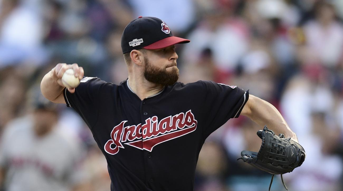 Cleveland Indians pitcher Corey Kluber throws against the Boston Red Sox in the fourth inning during Game 2 of baseball's American League Division Series, Friday, Oct. 7, 2016, in Cleveland. (AP Photo/David Dermer)