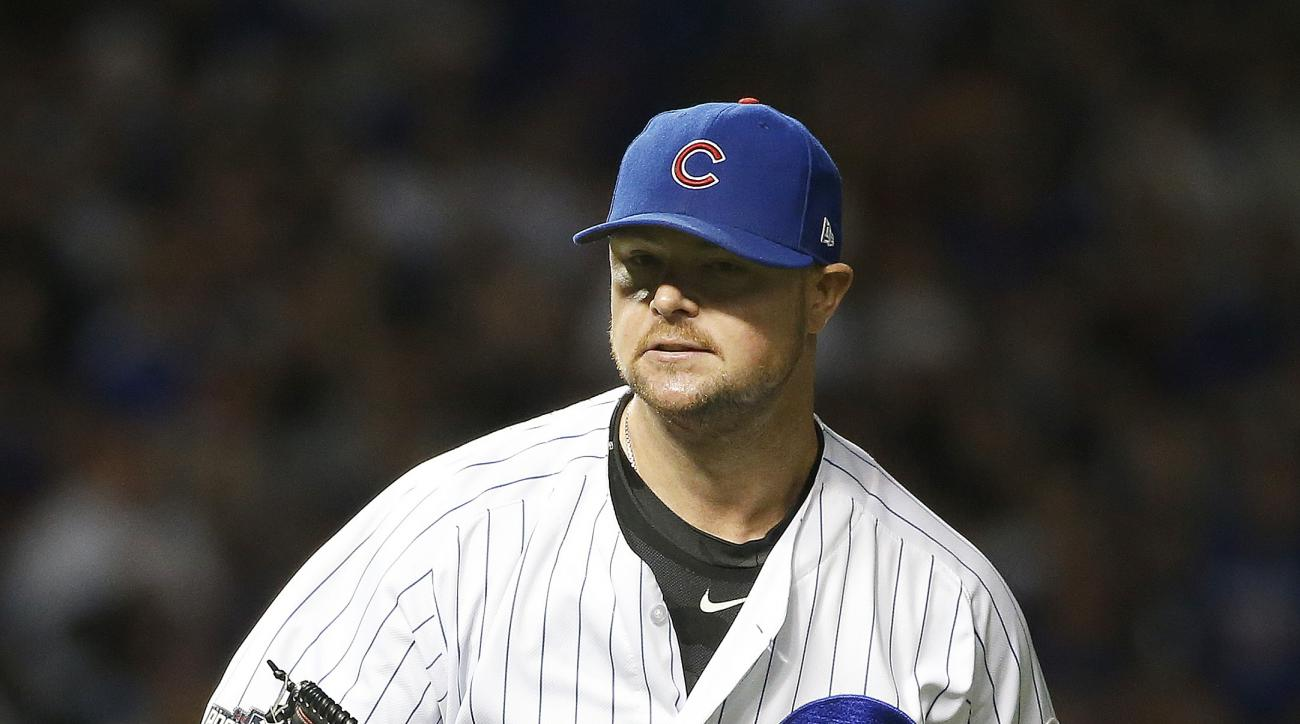 Chicago Cubs starting pitcher Jon Lester runs to the dugout after handling a grounder hit by San Francisco Giants' Buster Posey in the sixth inning of Game 1 of baseball's National League Division Series, Friday, Oct. 7, 2016, in Chicago. (AP Photo/Nam Y.