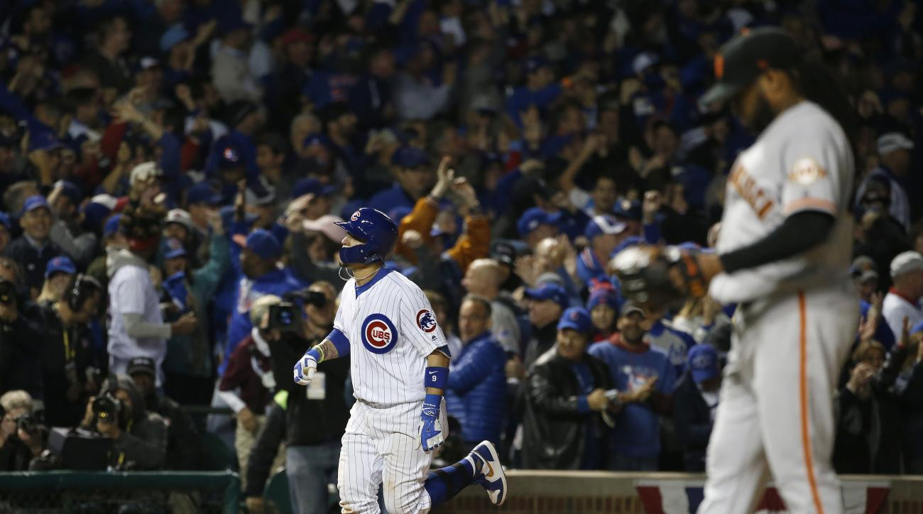 Chicago Cubs' Javier Baez runs bases after hitting a home run off San Francisco Giants starting pitcher Johnny Cueto, right, in the eighth inning of Game 1 of baseball's National League Division Series, Friday, Oct. 7, 2016, in Chicago. (AP Photo/Nam Y. H