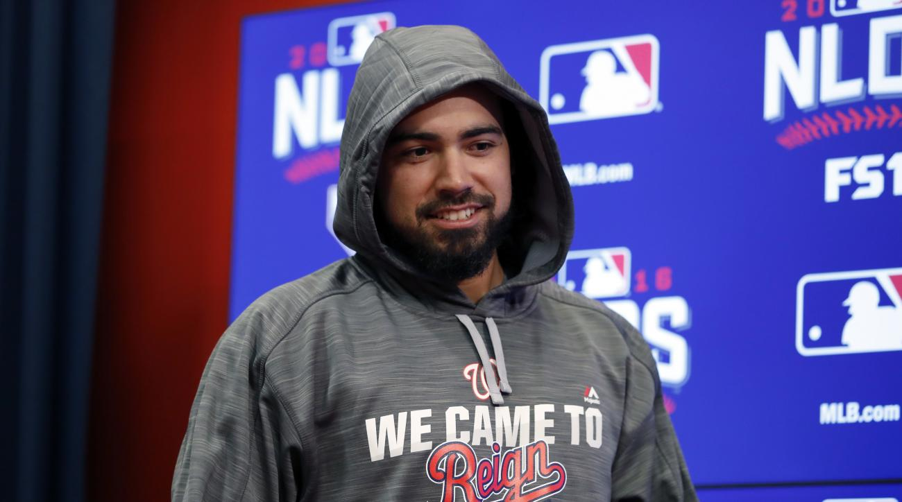 Washington Nationals third baseman Anthony Rendon arrives for a media availability before Game 2 of baseball's National League Division Series against the Los Angeles Dodgers at Nationals Park, Saturday, Oct. 8, 2016, in Washington. (AP Photo/Alex Brandon
