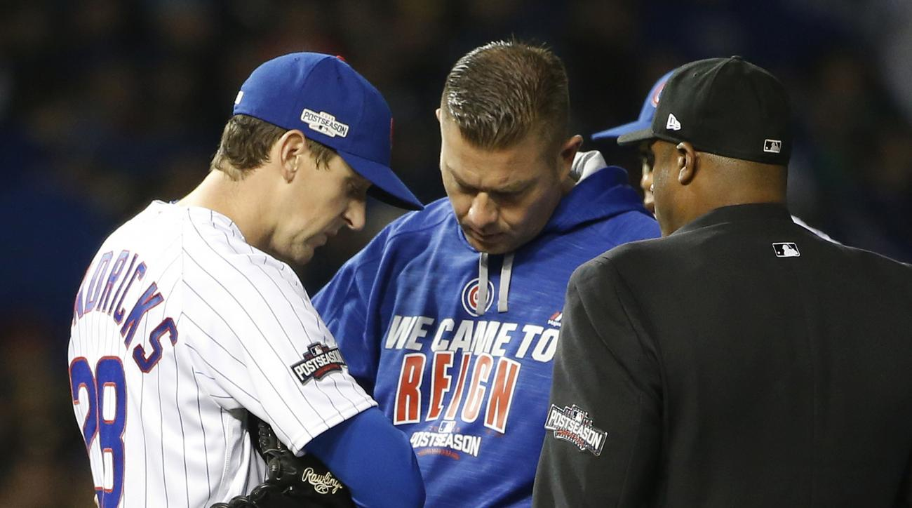 Chicago Cubs starting pitcher Kyle Hendricks (28) checks on his arm after getting hit by a ball in the fourth inning of Game 2 of baseball's National League Division Series, Saturday, Oct. 8, 2016, in Chicago. (AP Photo/Nam Y. Huh)