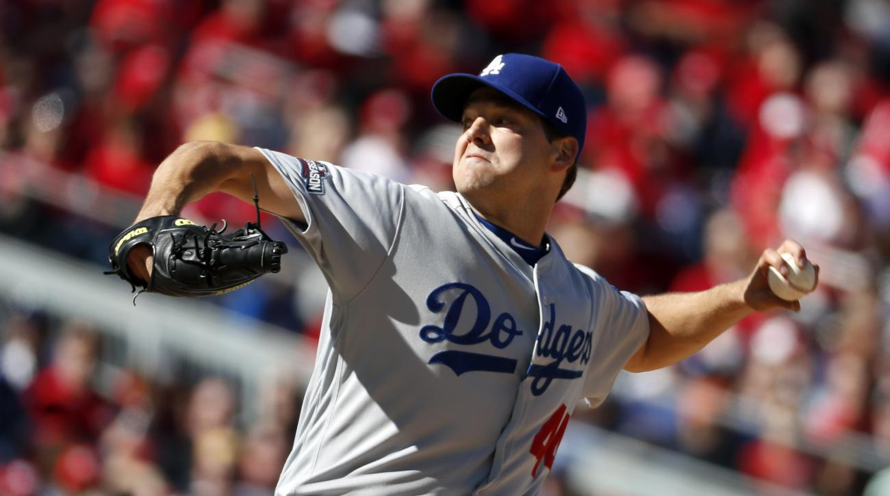 Los Angeles Dodgers starting pitcher Rich Hill throws in the third inning during Game 2 of baseball's National League Division Series against the Washington Nationals at Nationals Park, Sunday, Oct. 9, 2016, in Washington. (AP Photo/Alex Brandon)