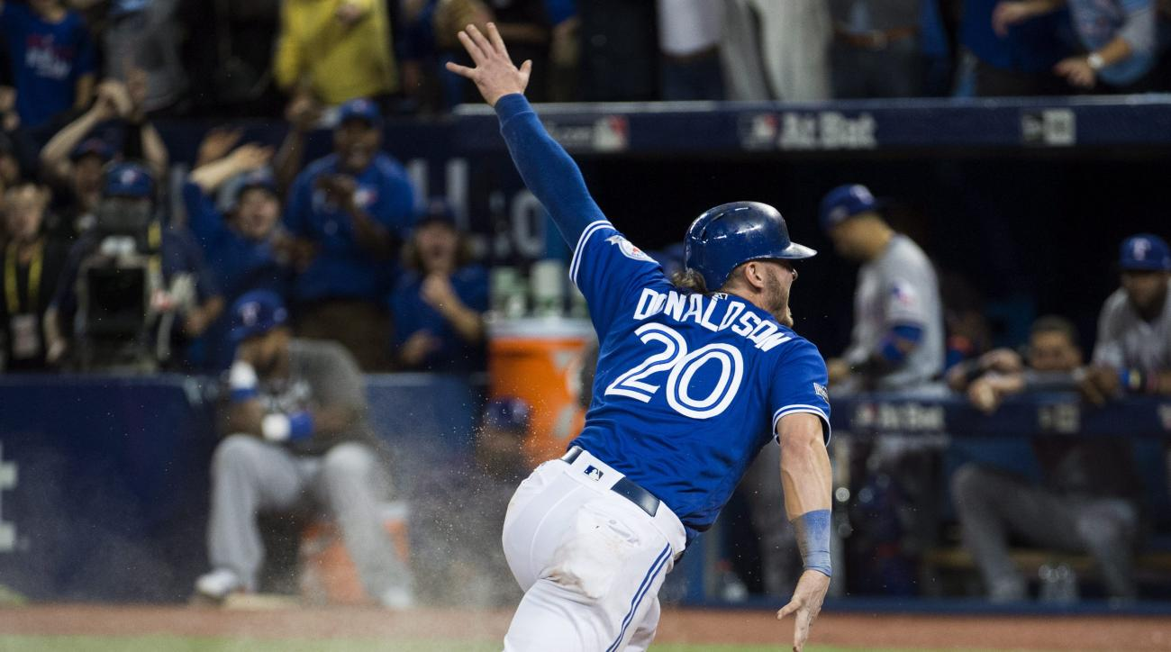 Toronto Blue Jays third baseman Josh Donaldson (20) reacts after scoring the game winning run against the Texas Rangers during tenth inning American League Division Series action in Toronto on Sunday, Oct. 9, 2016. (Nathan Denette/The Canadian Press via A