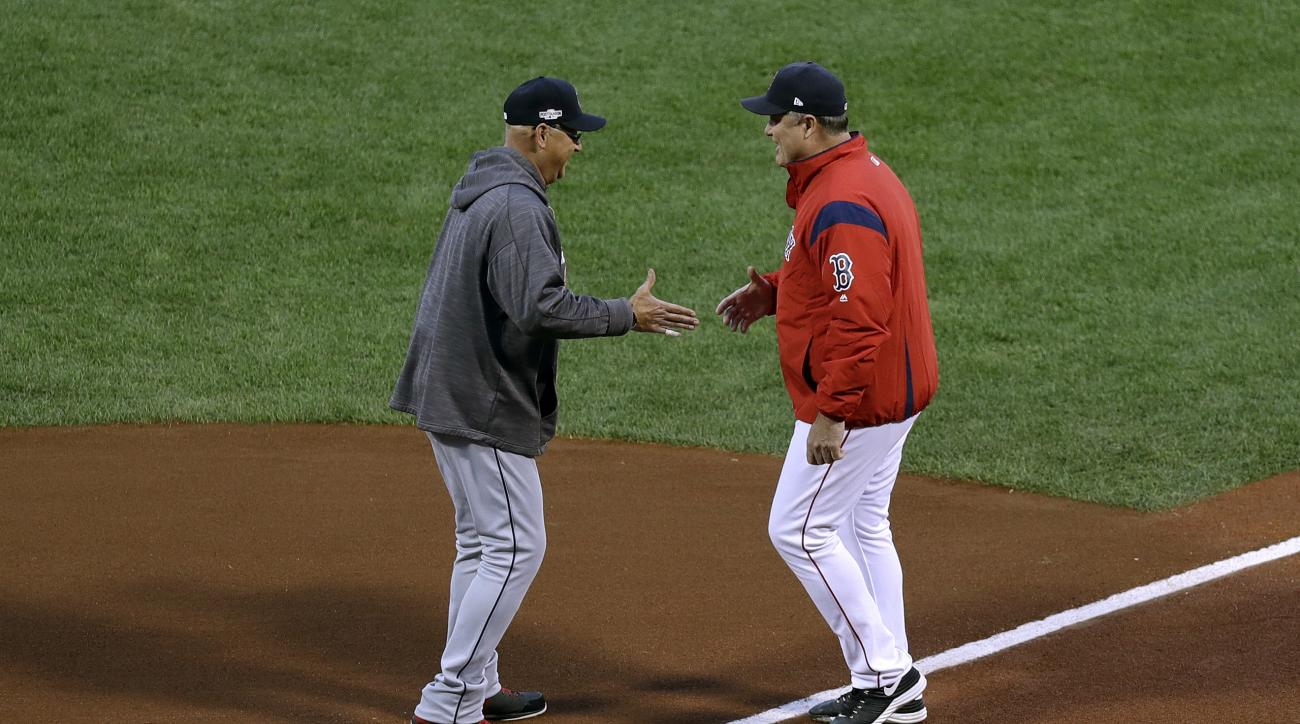 Cleveland Indians manager Terry Francona, left, shakes hands with Boston Red Sox manager John Farrell at home plate before Game 3 of baseball's American League Division Series, Monday, Oct. 10, 2016, in Boston. (AP Photo/Charles Krupa)