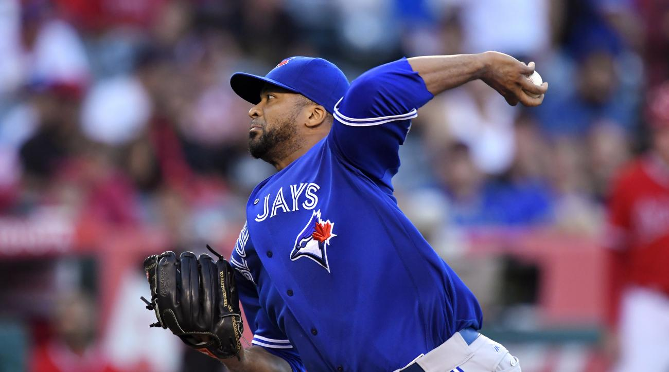 FILE - This Sept. 17, 2016 file photo shows Toronto Blue Jays starting pitcher Francisco Liriano throwing to the plate during the first inning of a baseball game against the Los Angeles Angels in Anaheim, Calif. Blue Jays general manager Ross Atkins expec