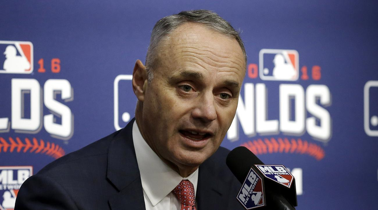Major League Baseball Commissioner Rob Manfred speaks at a news conference before Game 3 of baseball's National League Division Series between the San Francisco Giants and the Chicago Cubs in San Francisco, Monday, Oct. 10, 2016. (AP Photo/Ben Margot)