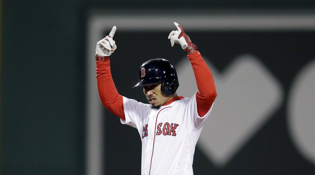 Boston Red Sox's Mookie Betts signals from second base after hitting a double against the Cleveland Indians during the sixth inning in Game 3 of baseball's American League Division Series, Monday, Oct. 10, 2016, in Boston. (AP Photo/Charles Krupa)