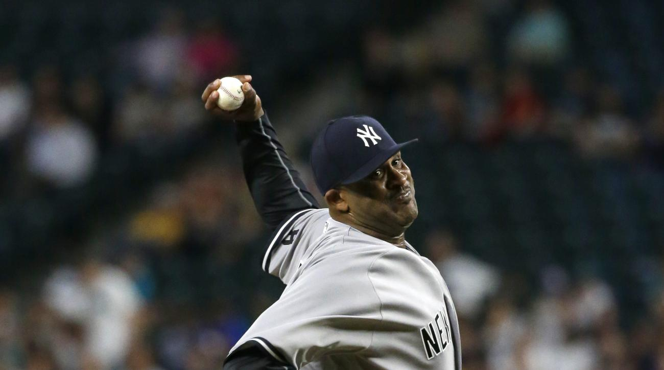FILE - In this Aug. 23, 2016, file photo, New York Yankees starting pitcher CC Sabathia throws against the Seattle Mariners during a baseball game, in Seattle. Sabathia has had surgery on his troublesome right knee. New York head team physician Dr. Christ