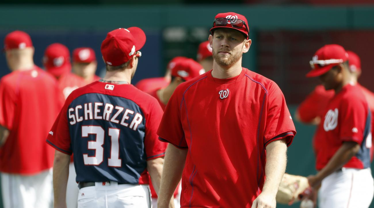 FILE - In this Tuesday, Oct. 4, 2016, file photo, Washington Nationals starting pitcher Stephen Strasburg walk on the field during baseball batting practice at Nationals Park, in Washington. Strasburg's bullpen session at Dodger Stadium was cut short afte