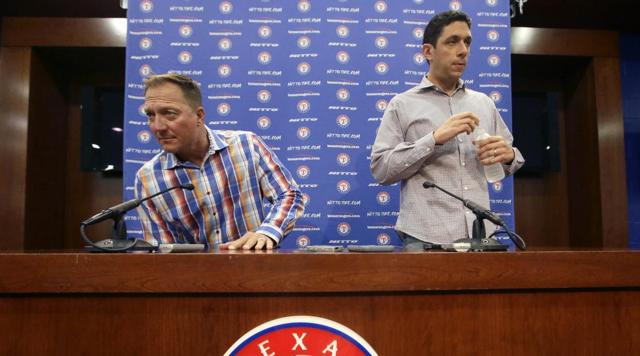 Texas Rangers manager Jeff Banister, left, and general manager Jon Daniels arrive to speak to reporters at the baseball park in Arlington, Texas, Tuesday, Oct. 11, 2016. What's next for \Daniels and the Texas Rangers? Instead of a long postseason run led