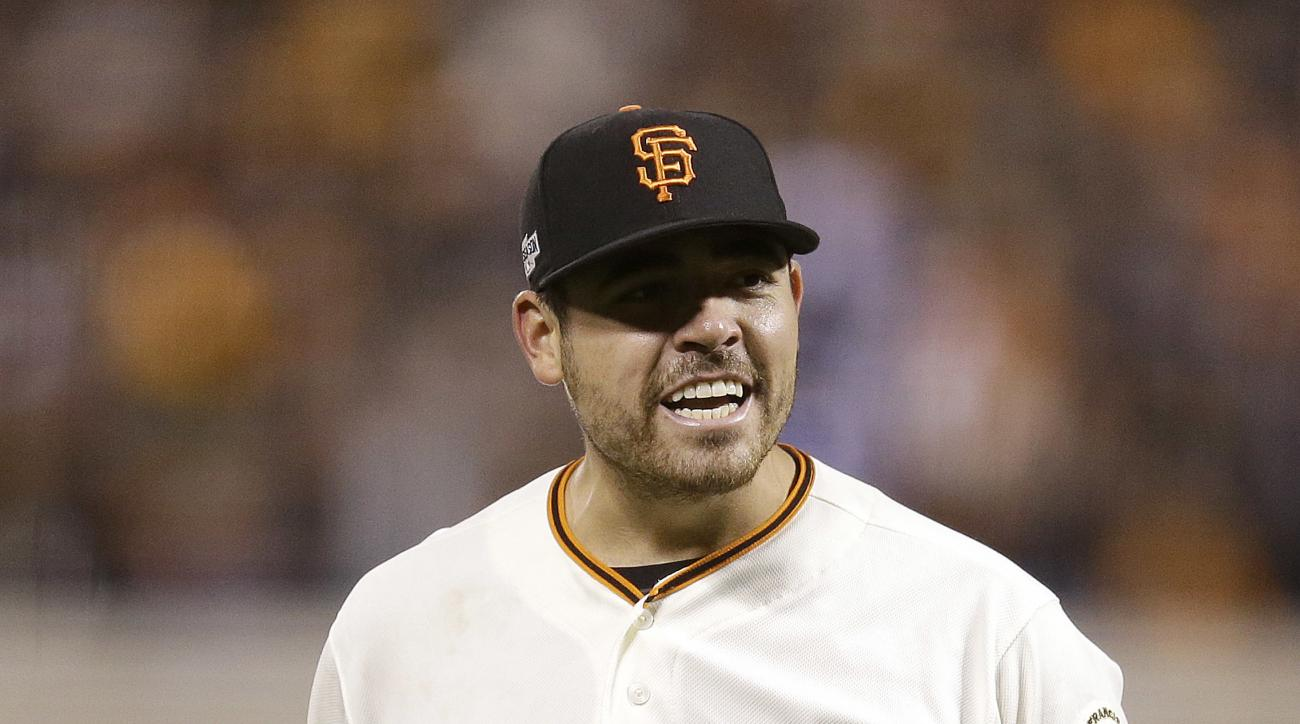 San Francisco Giants pitcher Matt Moore reacts after striking out Chicago Cubs' Dexter Fowler during the eighth inning of Game 4 of baseball's National League Division Series in San Francisco, Tuesday, Oct. 11, 2016. (AP Photo/Ben Margot)