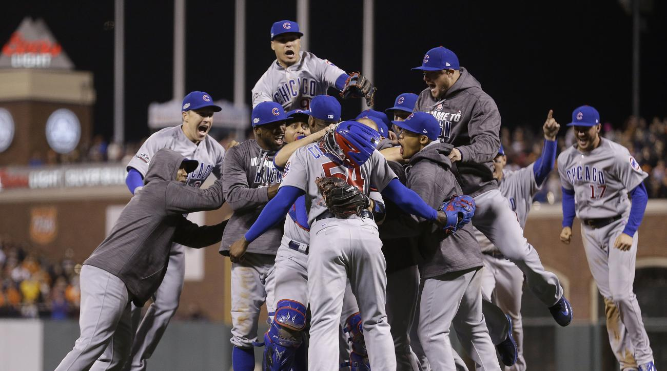 Chicago Cubs players celebrate around pitcher Aroldis Chapman, center foreground, after Game 4 of baseball's National League Division Series against the San Francisco Giants in San Francisco, Tuesday, Oct. 11, 2016. The  Cubs won 6-5. (AP Photo/Ben Margot
