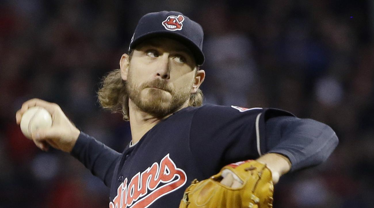 FILE - In this Oct. 10, 2016, file photo, Cleveland Indians starting pitcher Josh Tomlin delivers against the Boston Red Sox during the first inning in Game 3 of baseball's American League Division Series in Boston. Manager Terry Francona said Wednesday h