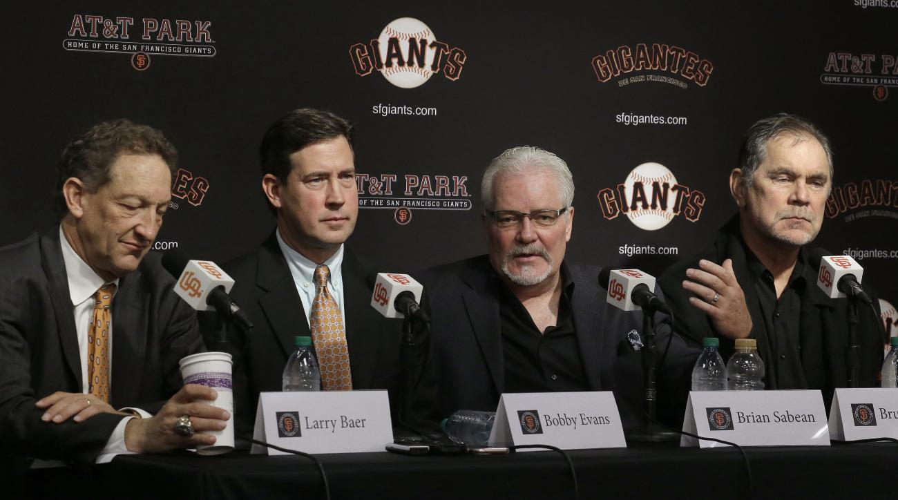 San Francisco Giants Executive Vice President of Baseball Operations Brian Sabean, second from right, gestures while speaking at a media conference beside, from left, Giants President and CEO Larry Baer, Senior Vice President and General Manager Bobby Eva