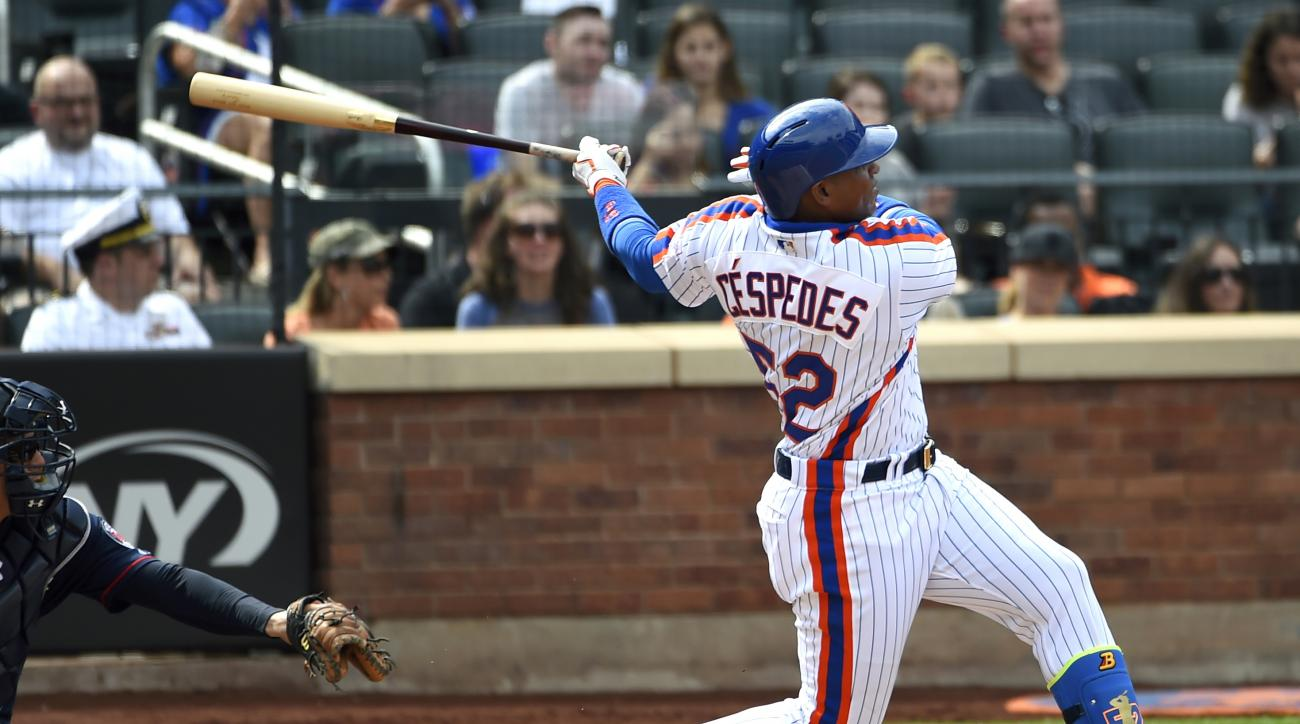 FILE - In this Sept. 18, 2016, file photo, New York Mets' Yoenis Cespedes swings for a double as John Ryan Murphy catches for the Minnesota Twins in the third inning of a baseball game, in New York. The price of qualifying offers for Major League Baseball
