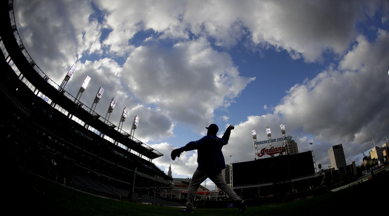 A member of the Toronto Blue Jays warms up during batting practice in Cleveland, Thursday, Oct. 13, 2016, in preparation for Game 1 of baseball's American League Championship Series. The Blue Jays will face the Cleveland Indians on Friday. (AP Photo/Matt
