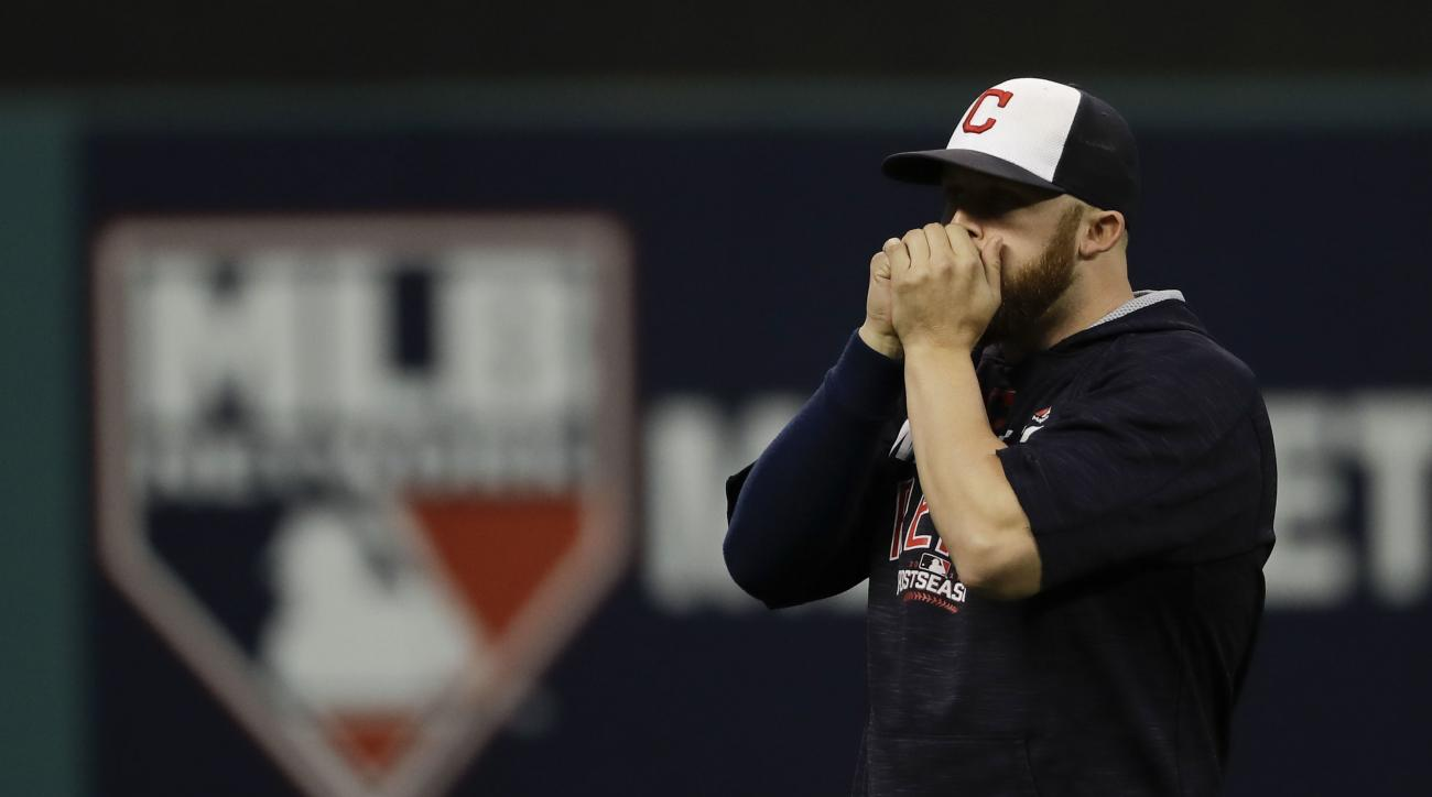 Cleveland Indians relief pitcher Cody Allen warms his hands during batting practice in Cleveland, Thursday, Oct. 13, 2016, in preparation for Game 1 of baseball's American League Championship Series. The Toronto Blue Jays are scheduled to face the Indians